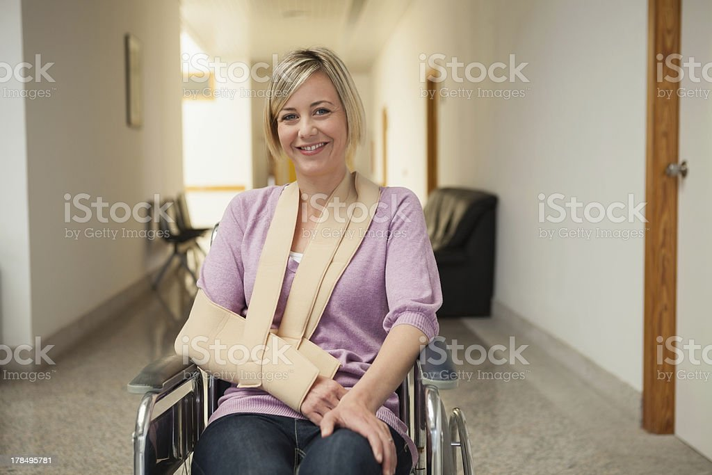 Patient in wheelchair with broken arm stock photo