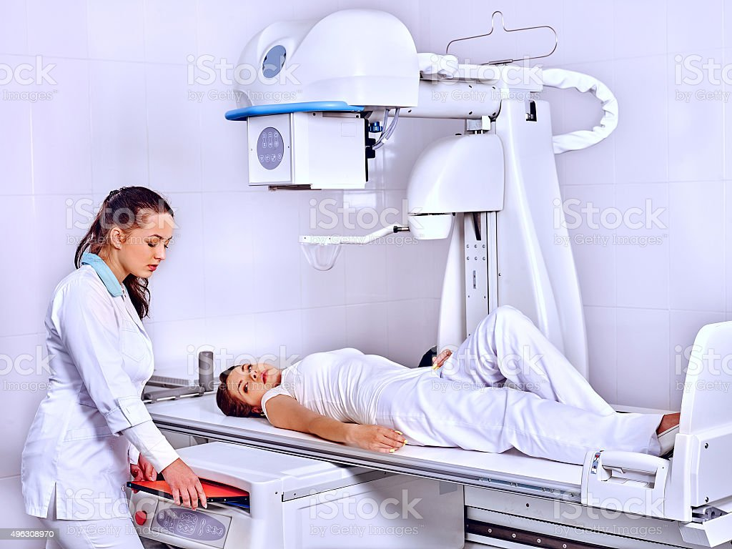 Patient  in x-ray room looking at doctor stock photo