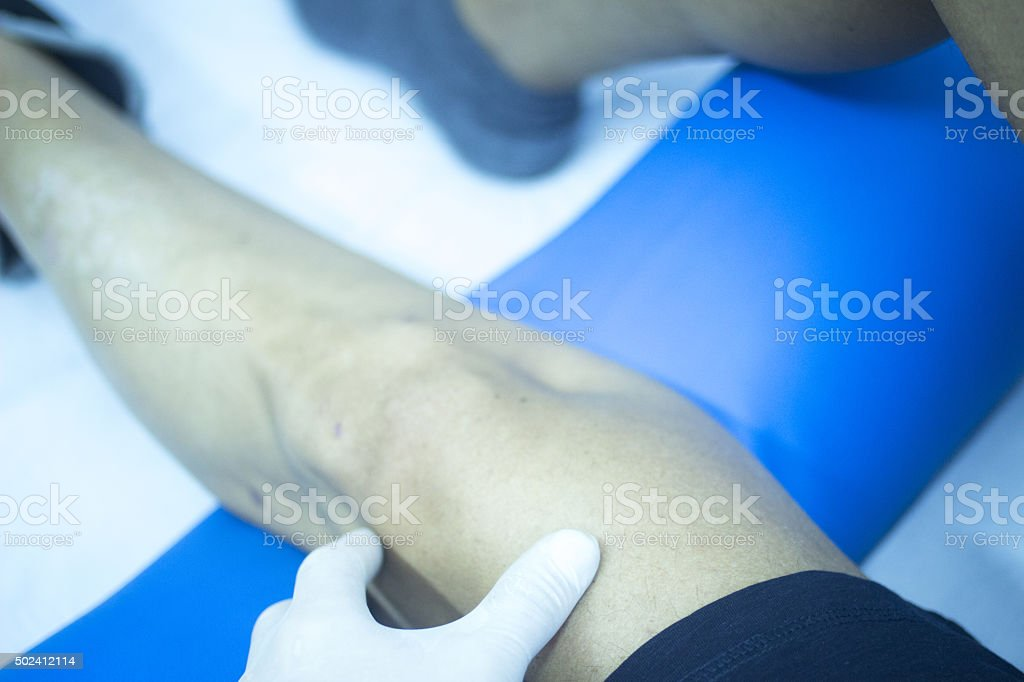 Patient leg in physical therapy physiotherapy stock photo