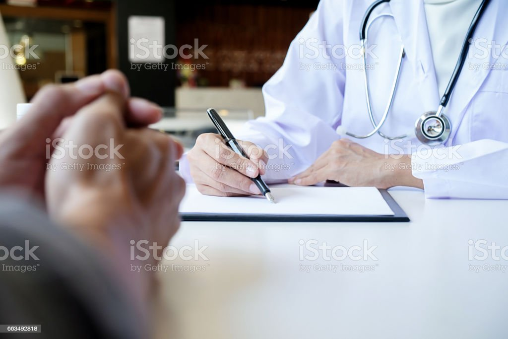 patient listening intently to a male doctor explaining patient symptoms or asking a question as they discuss paperwork together in a consultation   Stock photo ID: 610816619   S M L Size Guide Large     4896 px x 3264 px     41.5cm x 27.6cm @ 300 dpi    U stock photo