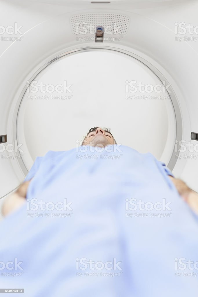 Patient lying in CT scanner stock photo