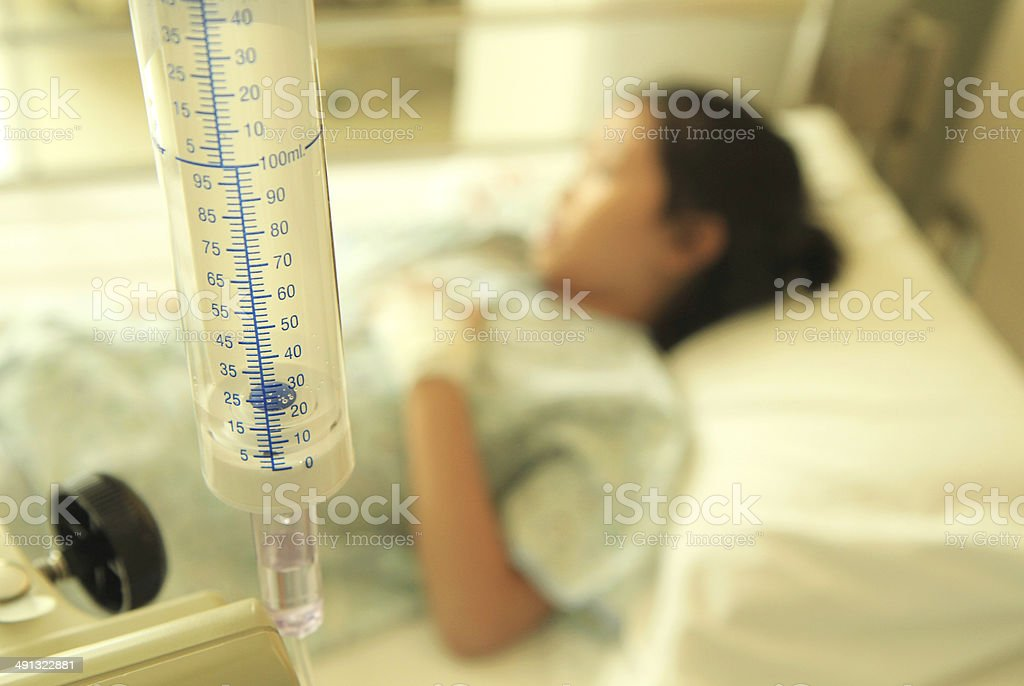Patient on hospital bed stock photo
