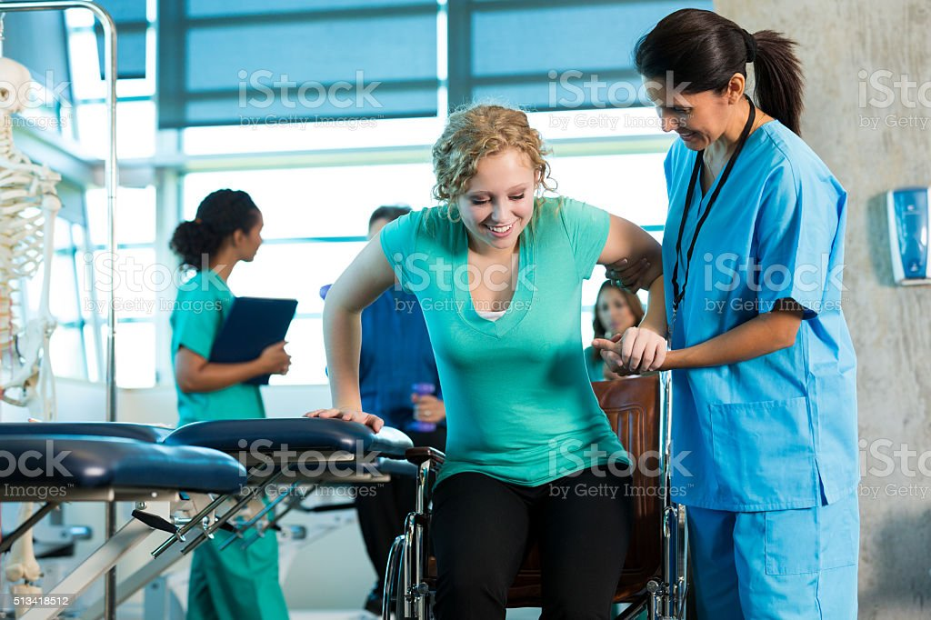 Patient receives physical therapy stock photo