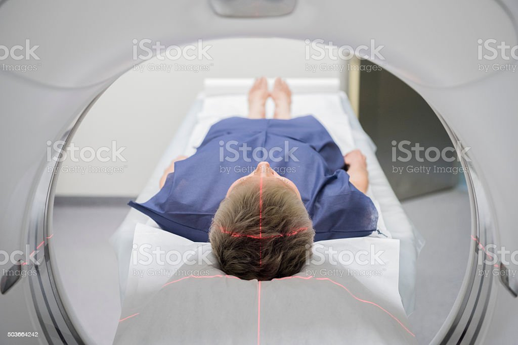 Patient receiving a CAT scan in hospital stock photo
