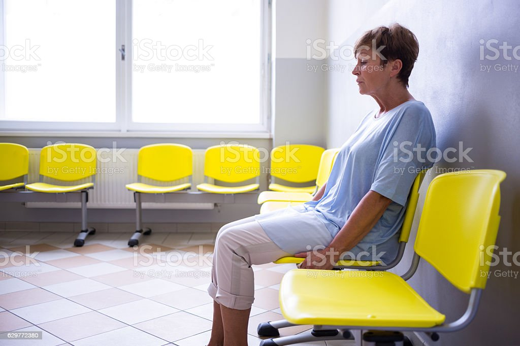 Patient sitting in a waiting room stock photo
