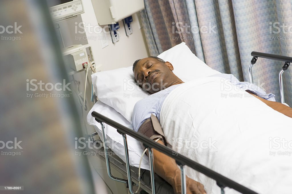 Patient Sleeping In Hospital Bed stock photo