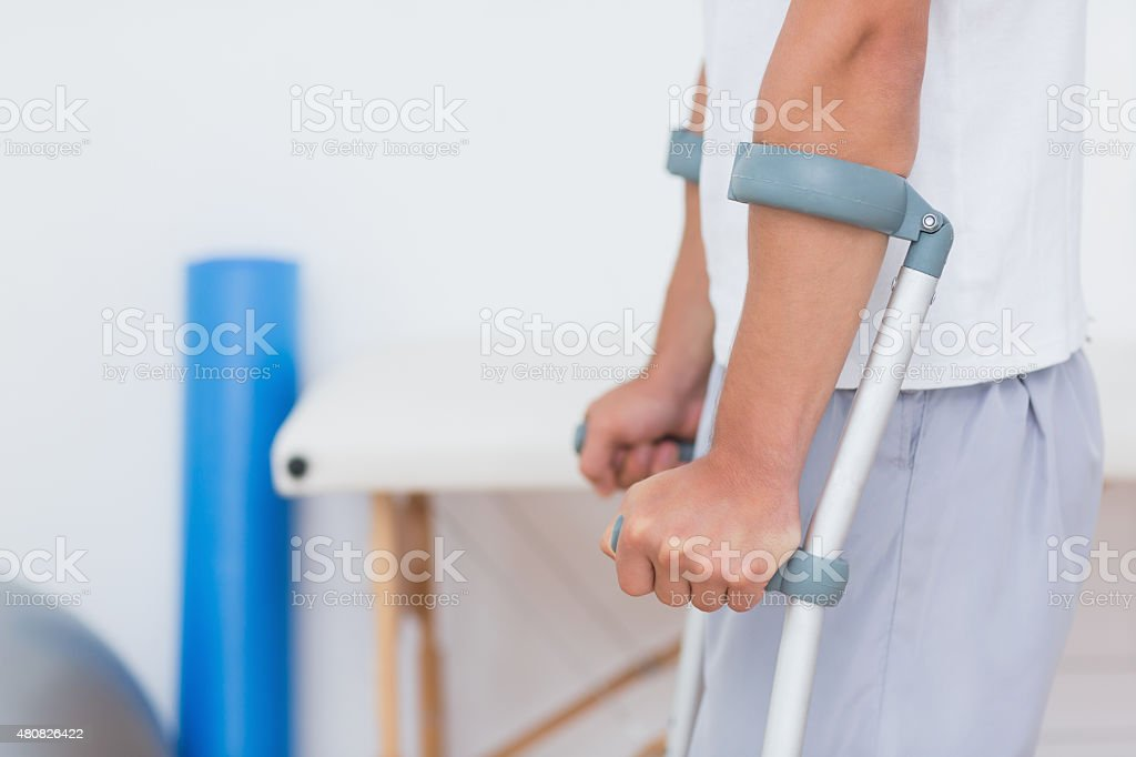 Patient standing with crutch stock photo