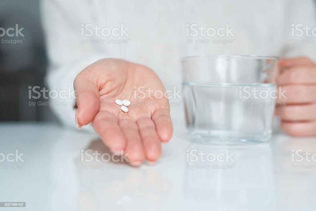 patient taking pills stock photo