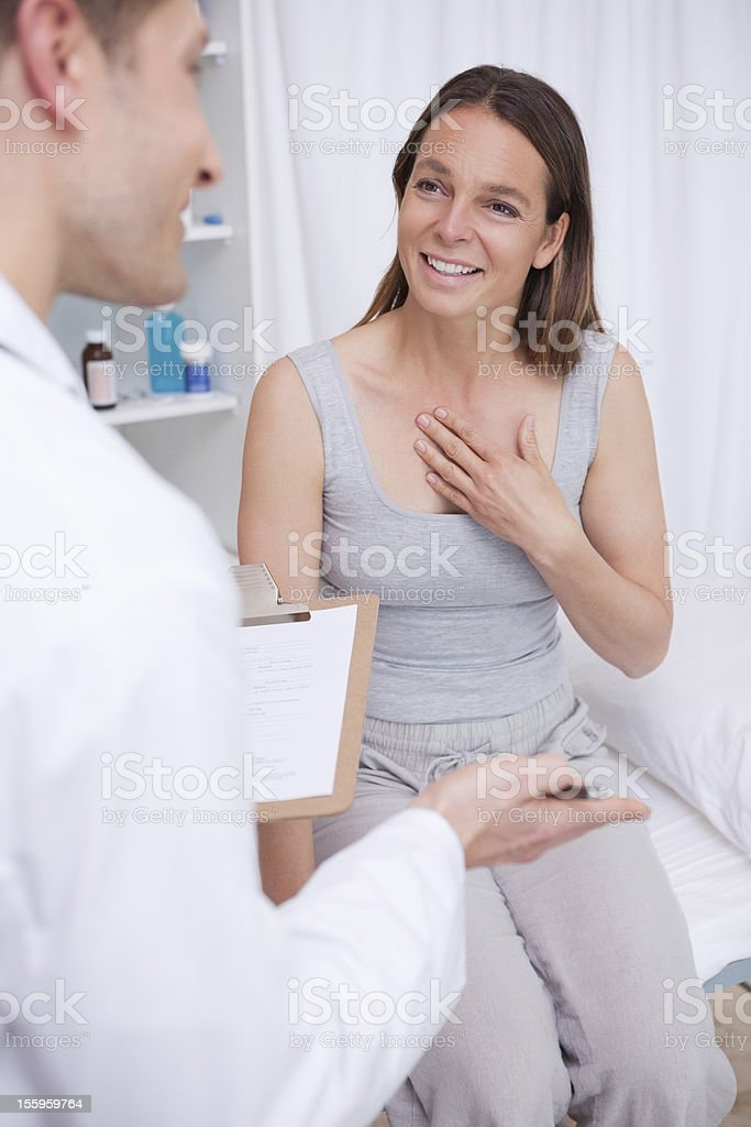 Patient talking to her doctor royalty-free stock photo