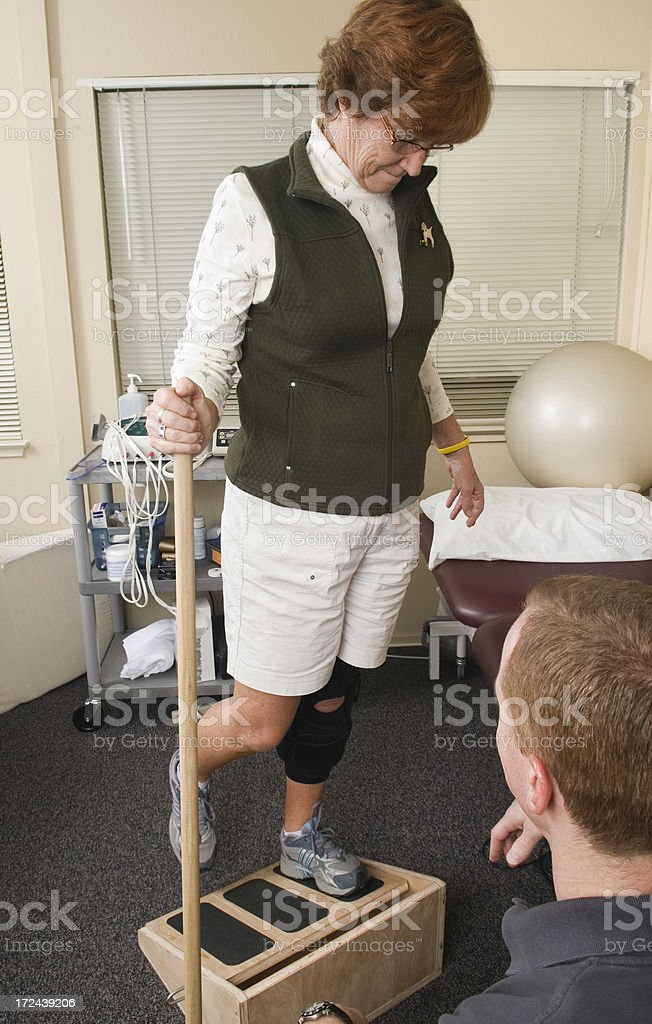 Patient with knee injury seeing a physical therapist. royalty-free stock photo