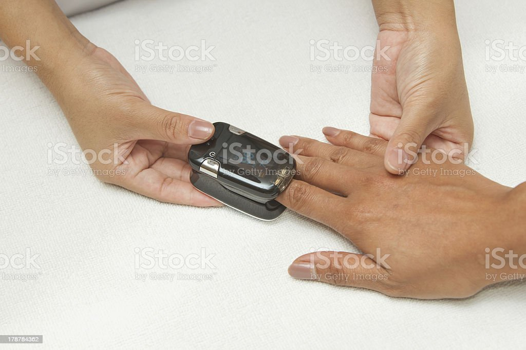 Patient with pulse oximeter on finger for monitoring stock photo