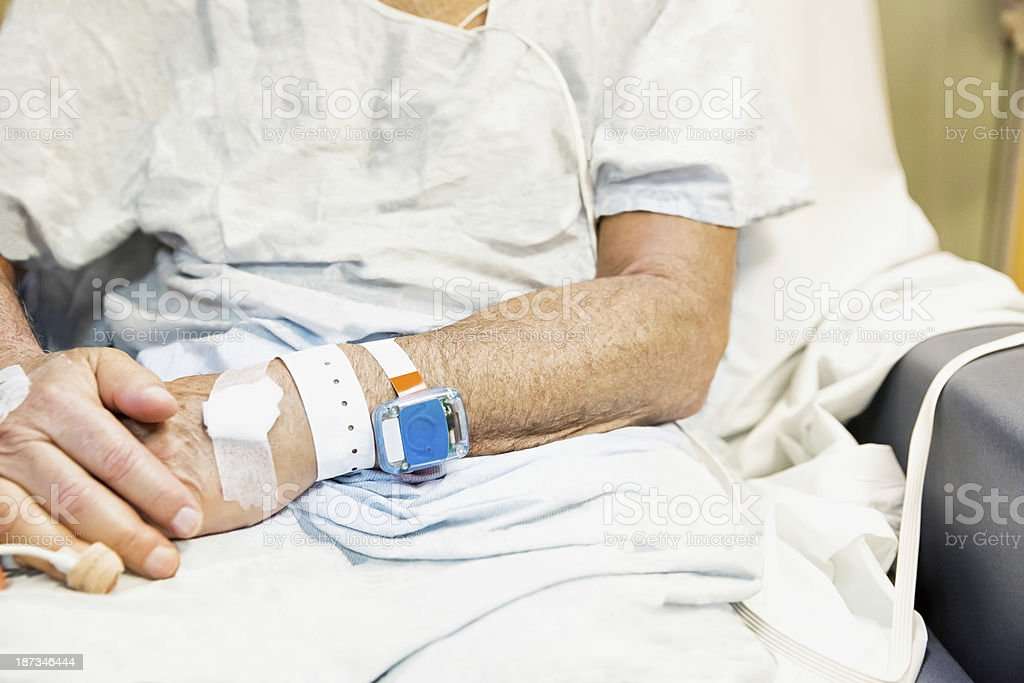 Patient with tracking device on their wrist stock photo