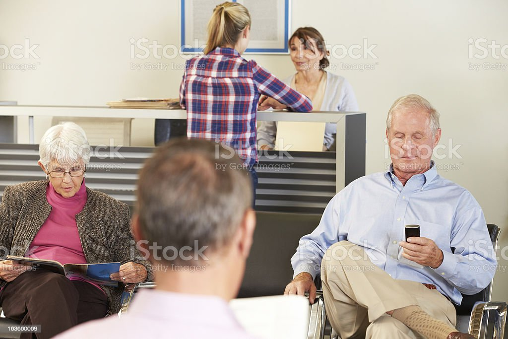 Patients In Doctor's Waiting Room stock photo