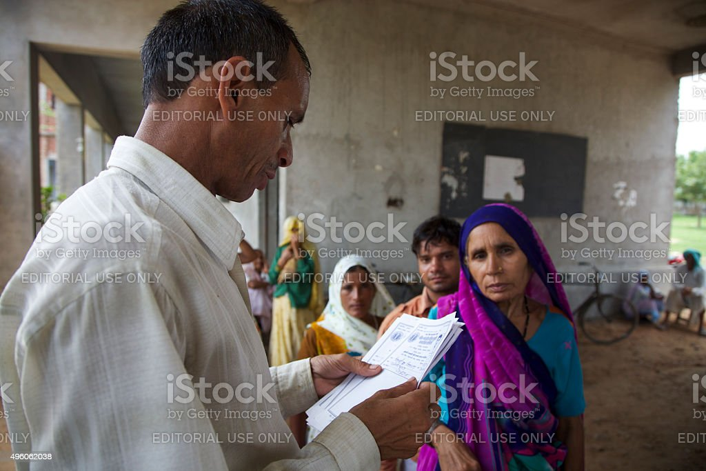 Patients queuing to have a free medical consultation in India stock photo