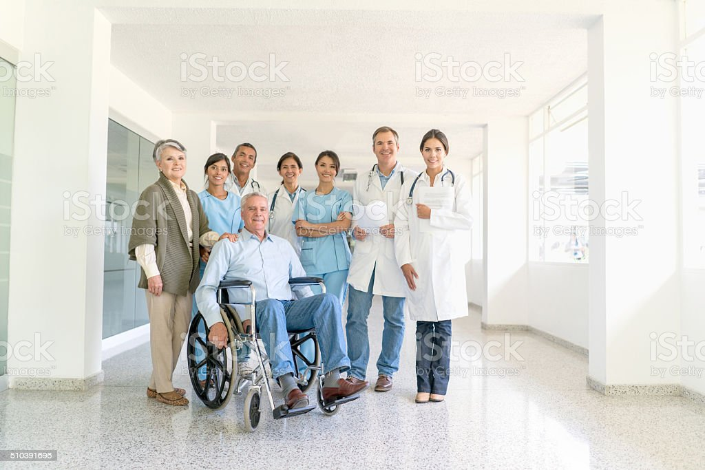 Patients with a group of doctors at the hospital stock photo