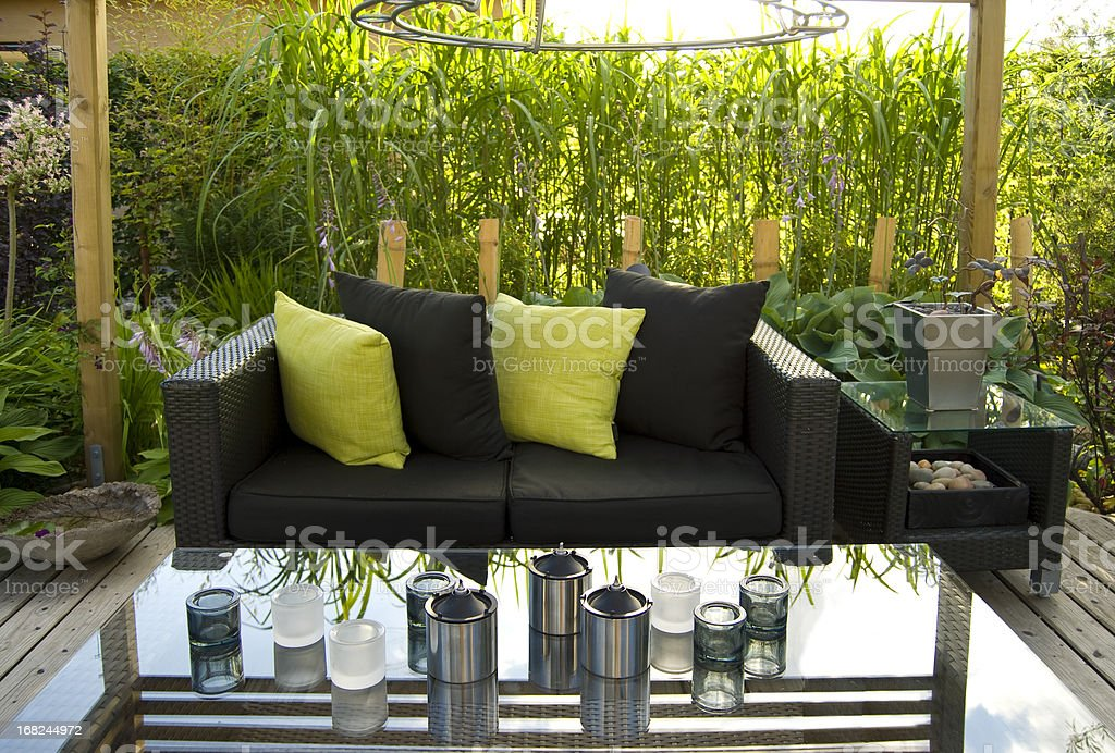 Patio and a modern wicker sofa stock photo