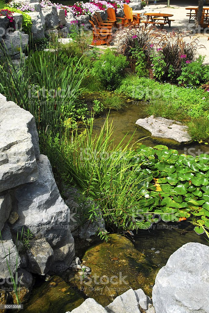 Patio and pond landscaping royalty-free stock photo