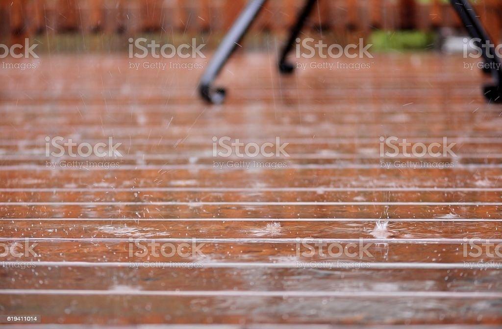 Patio/ deck in heavy rain. Selective focus. stock photo