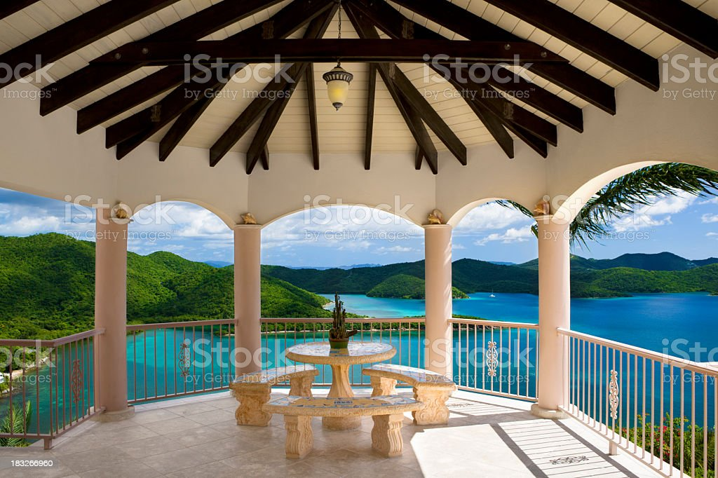 patio dining area in luxury Caribbean villa overlooking Virgin Islands stock photo