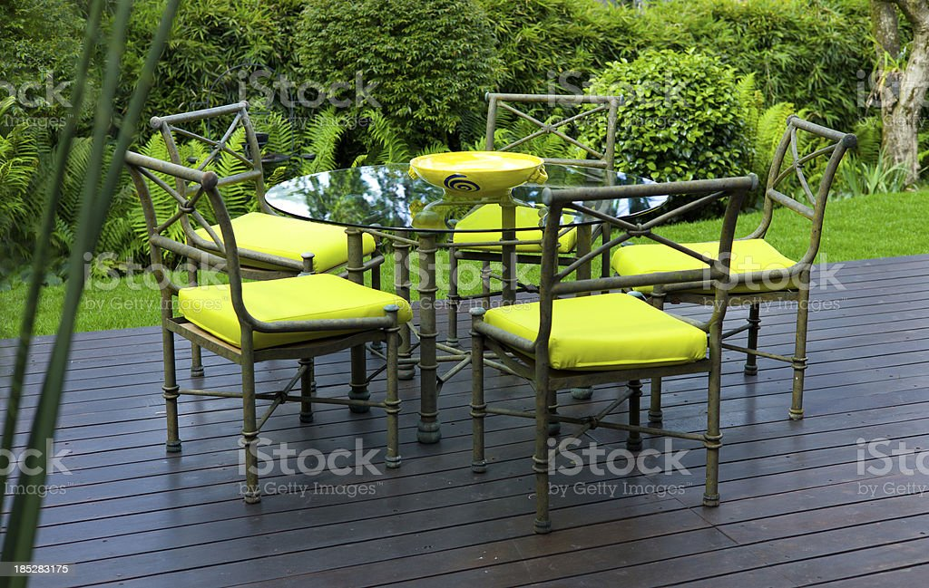 Patio (Terrace) Dining: Table and Chairs on Wooden Deck royalty-free stock photo