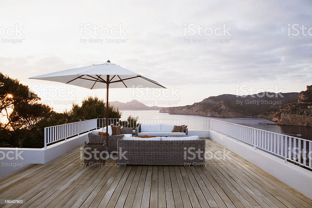 Patio furniture on modern deck royalty-free stock photo