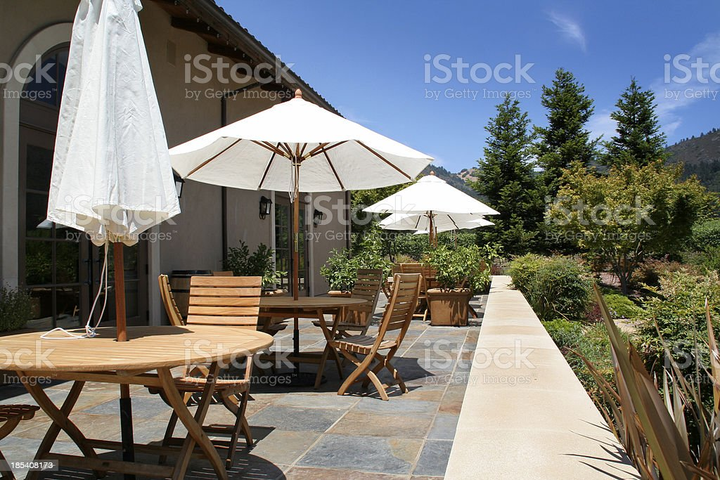 Patio Furniture, Teak Tables, Sun Umbrellas on Outdoor Balcony, Sonoma stock photo