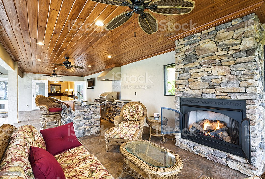 Patio living space with fireplace stock photo