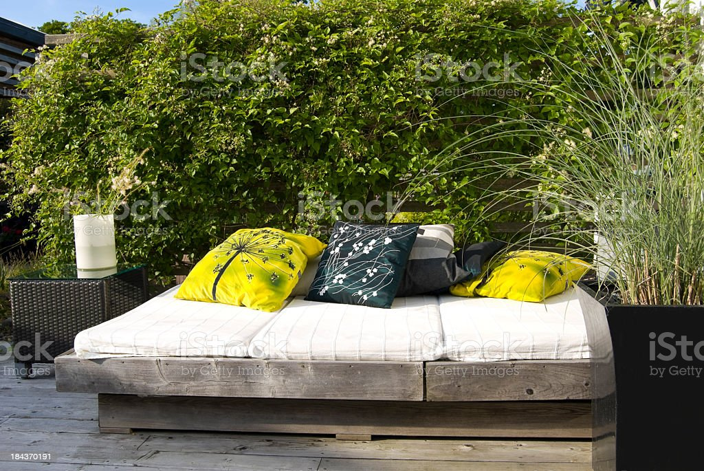 Patio outdoor bed or sofa royalty-free stock photo