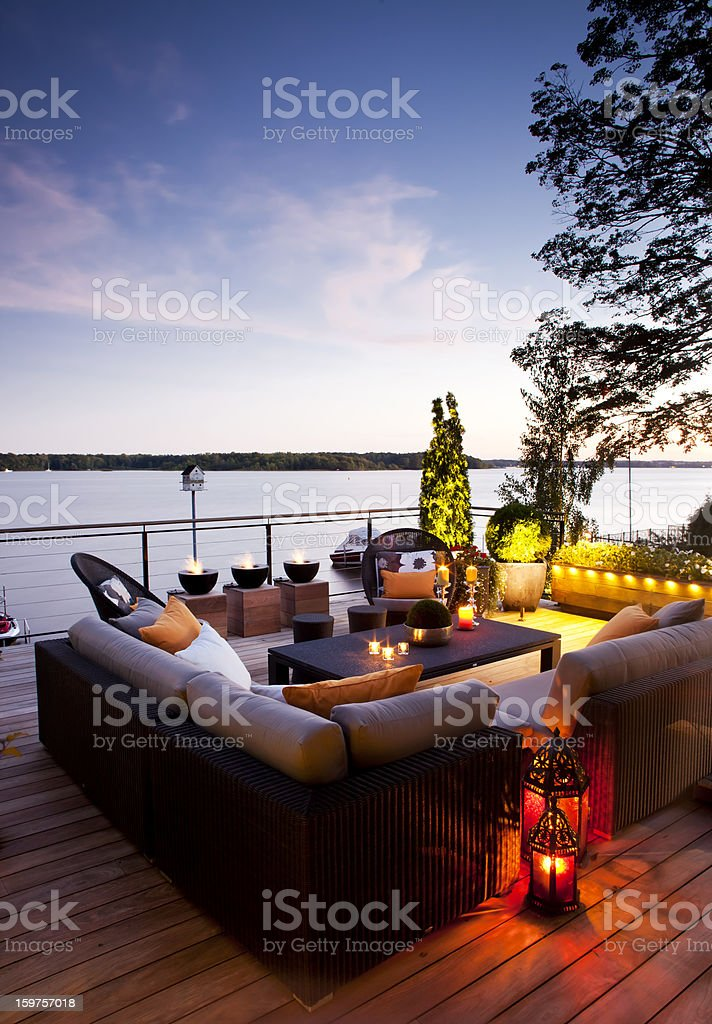 Patio over looking the lake at sunset. stock photo