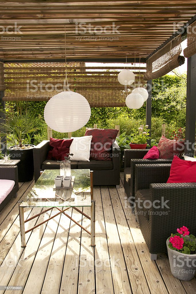 Patio with a pergola and modern outdoor furniture stock photo