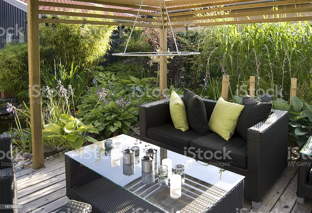 Patio with an outdoor wicker sofa and table stock photo