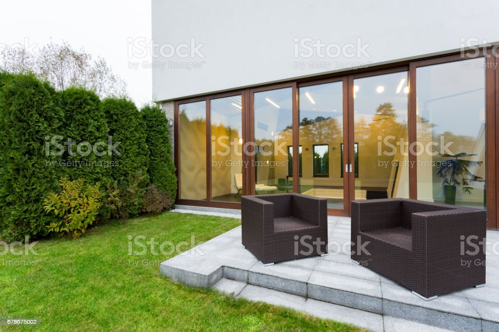Patio with garden furniture stock photo