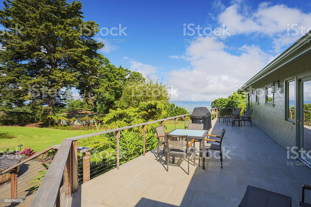 Patio with lounge chairs and view stock photo