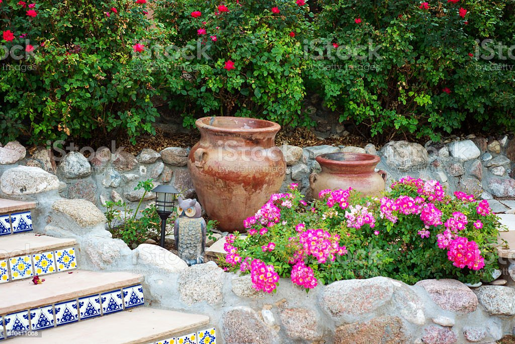 Patio with Roses, Tiled Stairs and Terracotta Pots stock photo