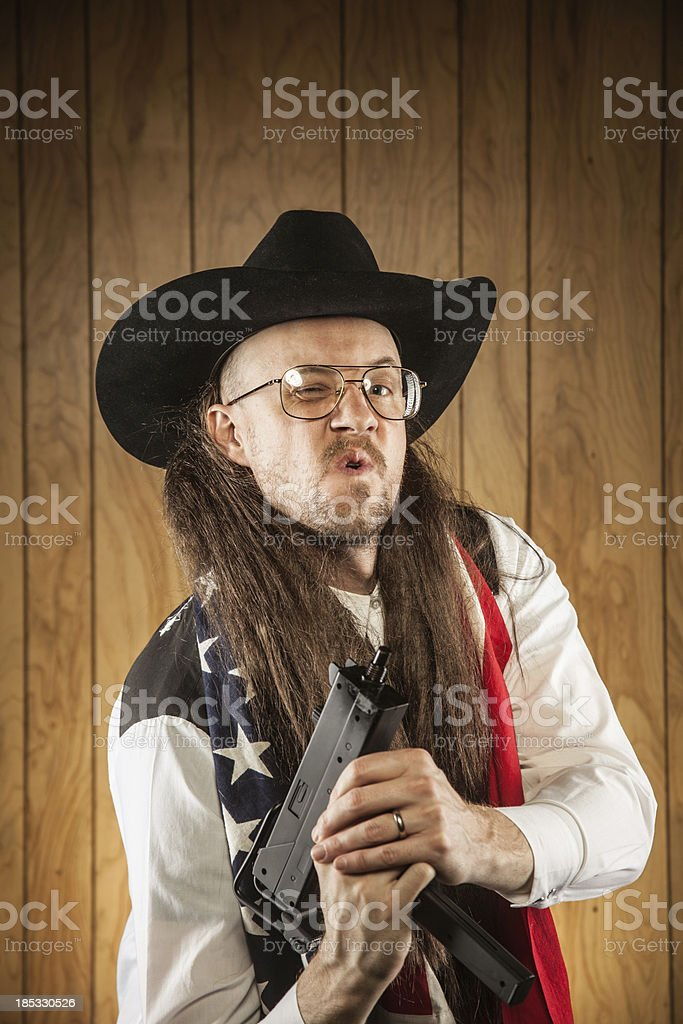 Patriot Mullet Redneck Cowboy with American Flag and Uzi Gun stock photo