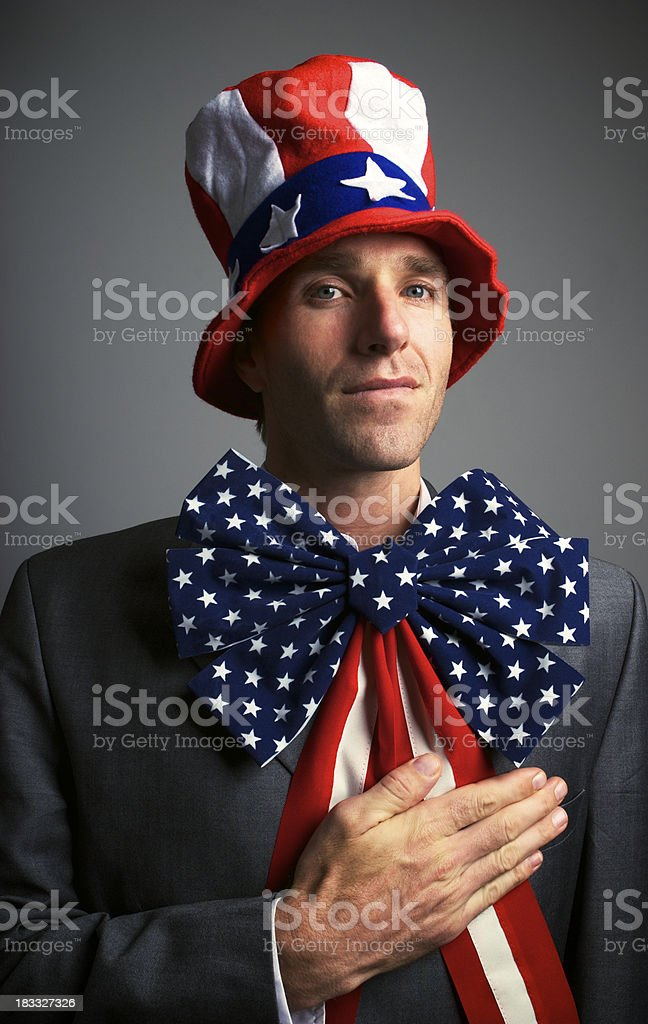 Patriotic American Puts Hand on Heart stock photo