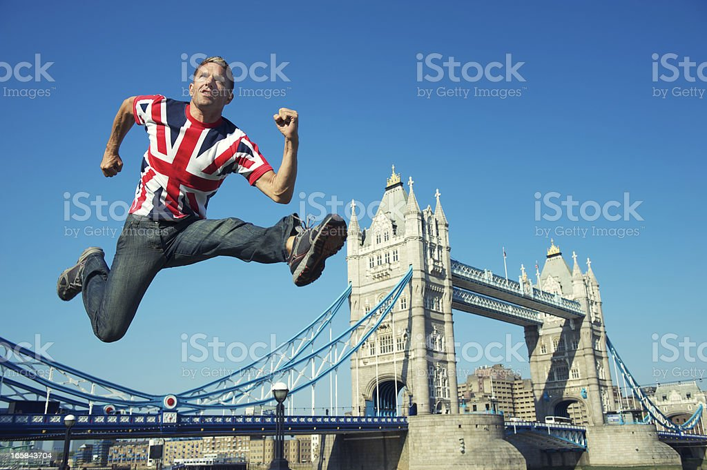 Patriotic Athletic Union Jack Man Jumps Over Tower Bridge London royalty-free stock photo