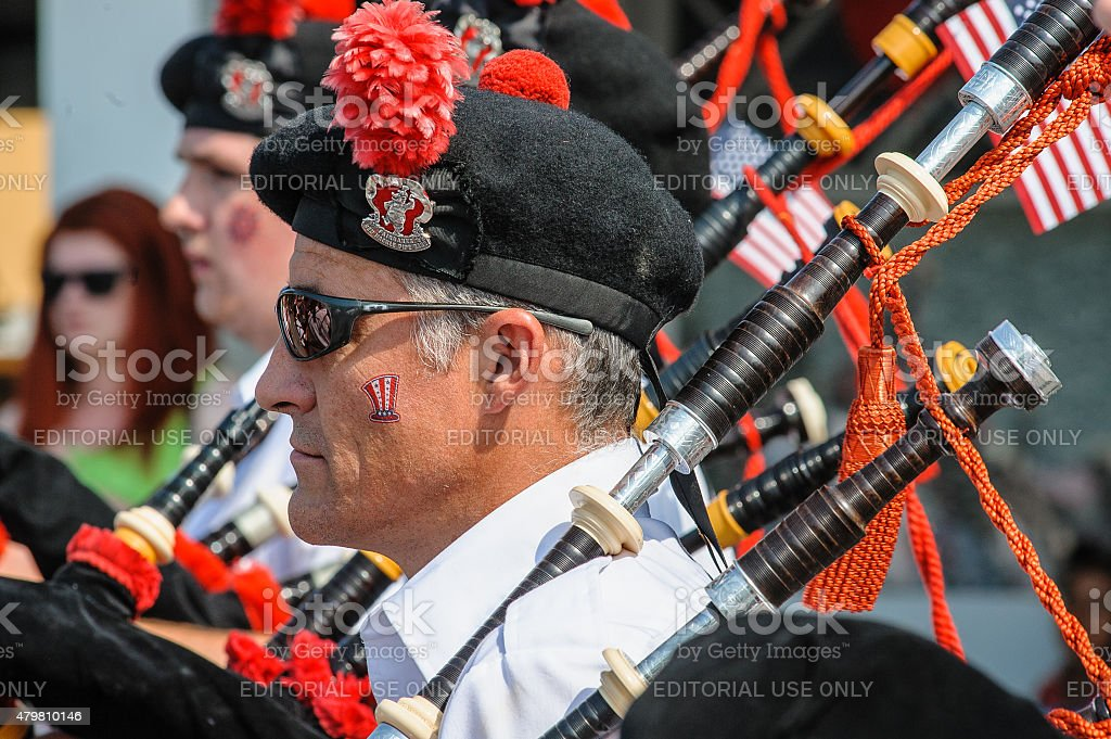 Patriotic Bagpiper stock photo