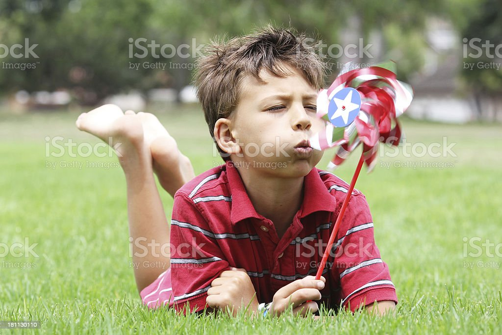 Patriotic boy with pinwheel royalty-free stock photo