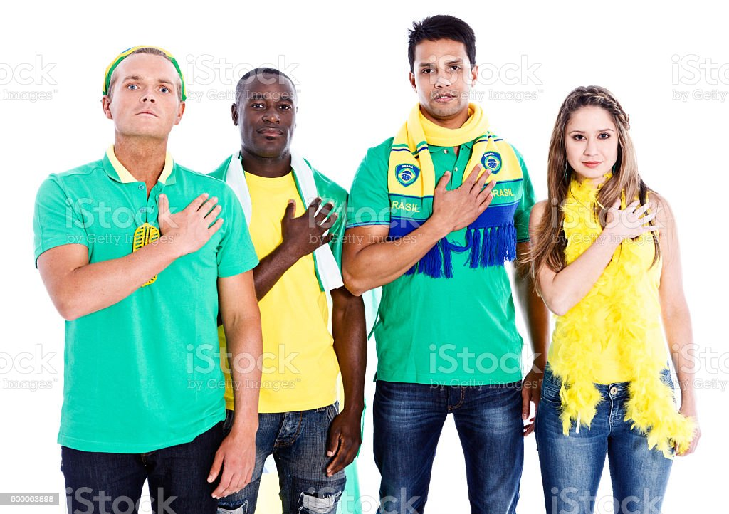 Patriotic Brazilian sports fans pledging allegiance stock photo