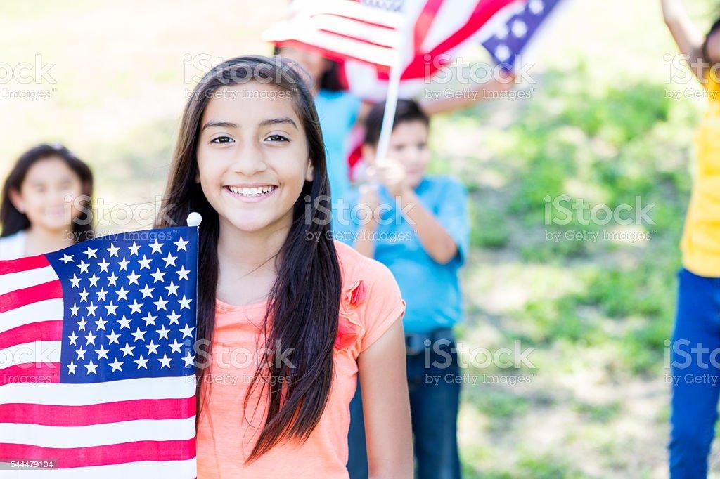 Patriotic children wave American flags stock photo