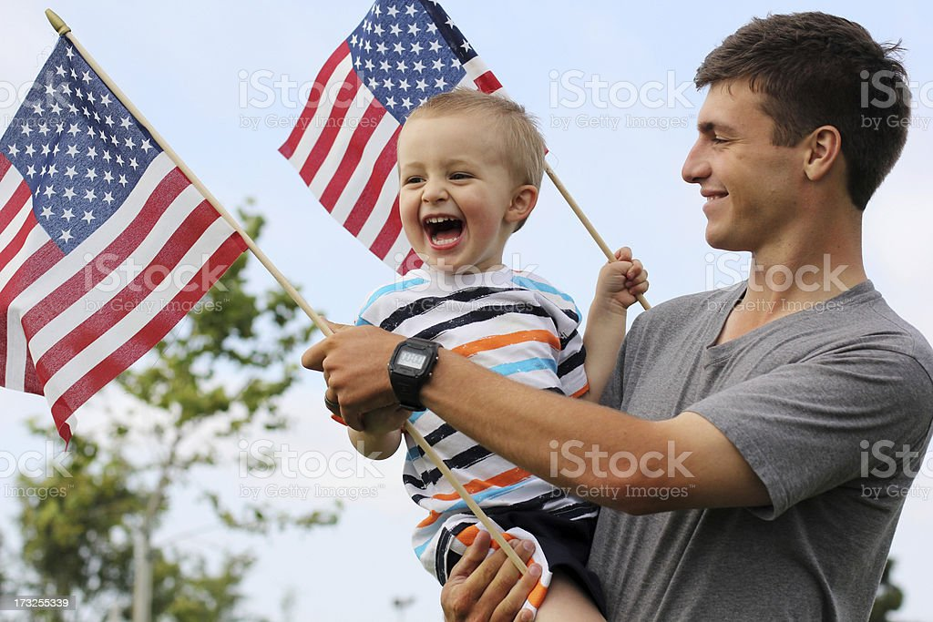 Patriotic dad and son royalty-free stock photo
