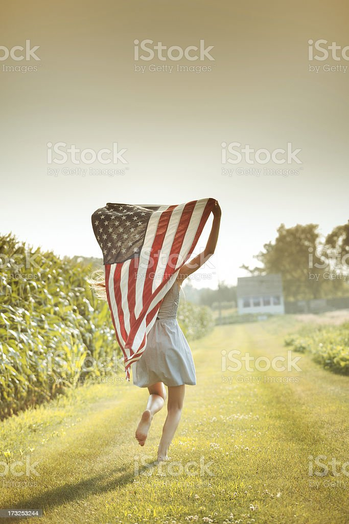 Patriotic Girl Flying American Flag, USA Fourth of July Banner stock photo