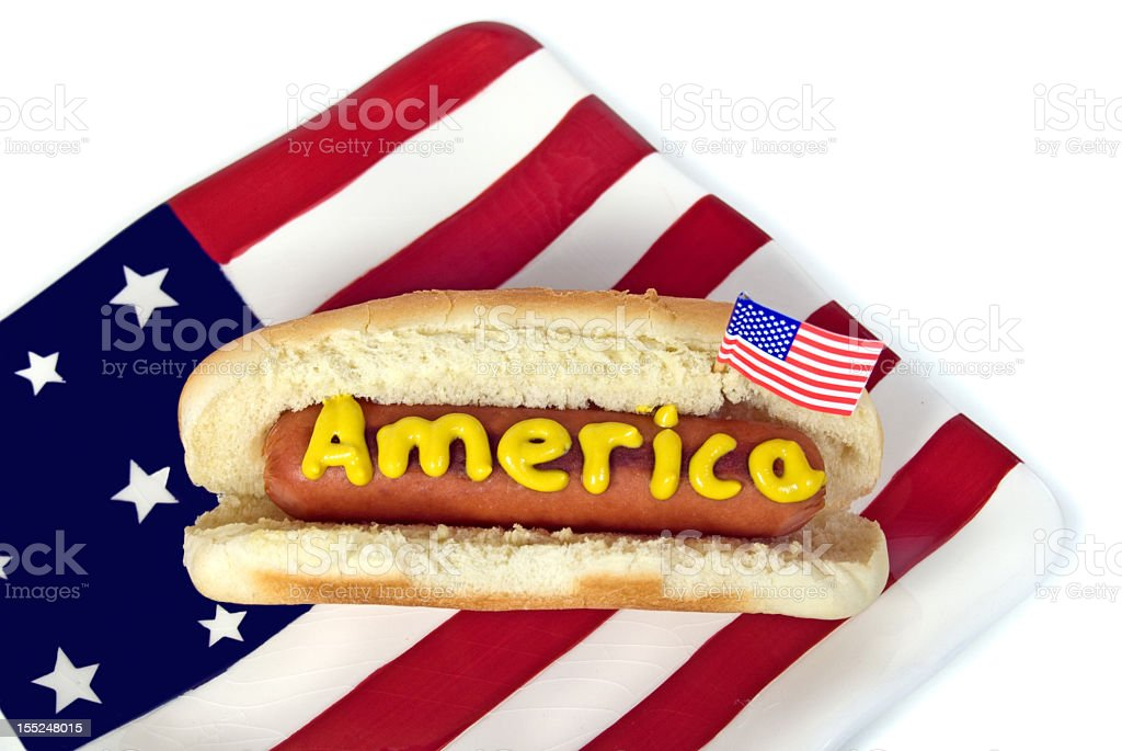 Patriotic hot dog with flag and mustard royalty-free stock photo