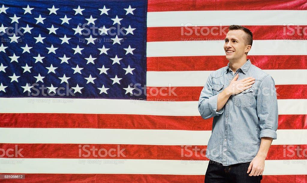 Patriotic man over American flag stock photo