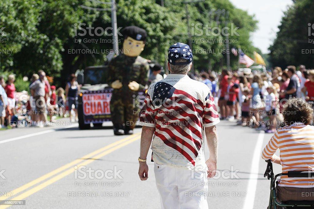 Patriotic Man Walking Toward July 4th Parade stock photo