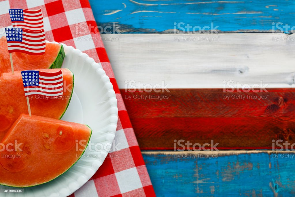 Patriotic Picnic with US Flags in Watermelon Slices stock photo