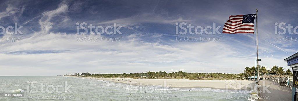 Patriotic pier panorama Gulf Coast ocean beach Florida USA royalty-free stock photo