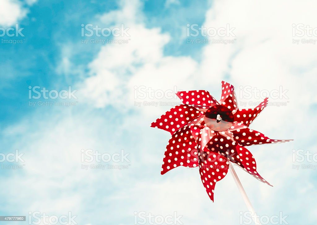Patriotic pinwheel spinning in the wind. July 4th summer backgrounds stock photo