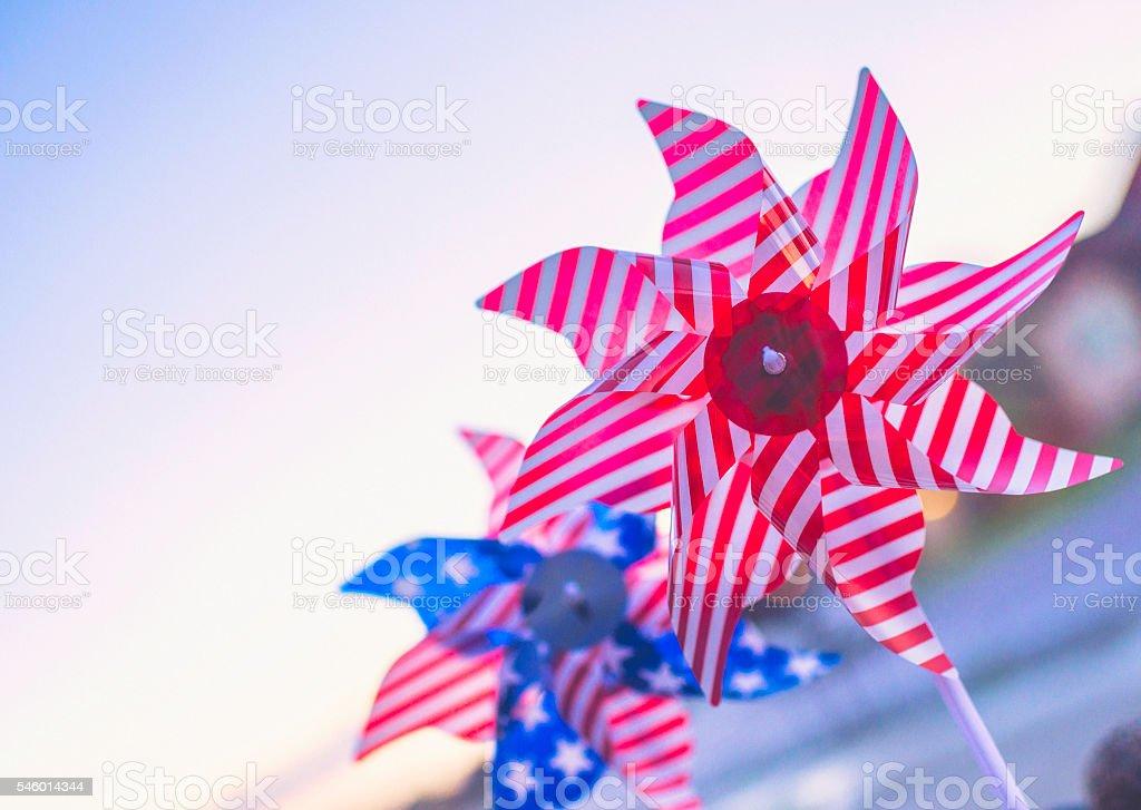 Patriotic pinwheels against blue sky stock photo